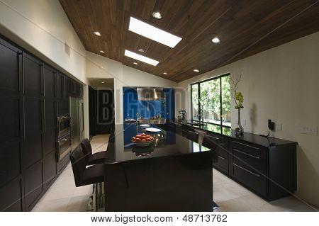 Breakfast bar in modern kitchen with skylights