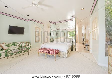 Minty fresh bedroom with leaf patterned sofa in house