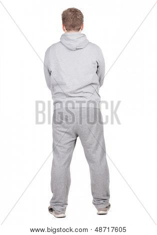Back view of young men athlete  Guy in tracksuit looks away. Rear view. Isolated over white background.