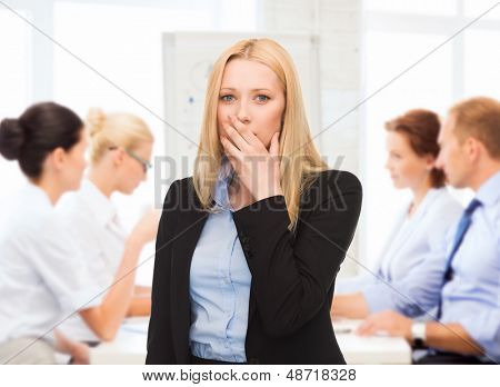 business concept - stressed businesswoman on meeting in office