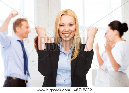 business and success - happy businesswoman celebrating succes in office