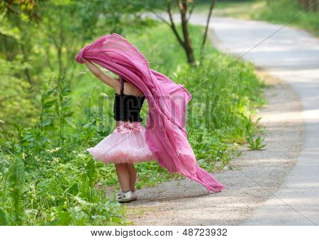 Little Girl Plays In A Park