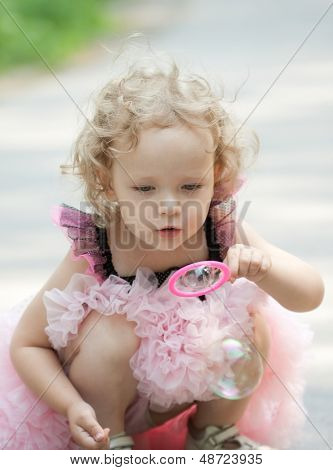 Girl Is Blowing Soap Bubbles