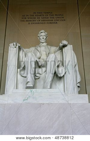 WASHINGTON, D.C. - JULY 29: The statue of Abraham Lincoln is shown at the Lincoln Memorial on July 29, 2013 in Washington, D.C. Vandals recently threw green paint on the statue (seen near right foot).