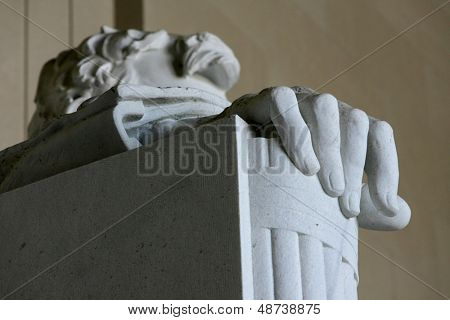 WASHINGTON, D.C. - JULY 29: The right hand of the statue of Abraham Lincoln is shown at the Lincoln Memorial on July 29, 2013 in Washington, D.C. The memorial was dedicated in 1922.