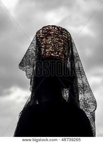 Woman Wearing A Headdress Of Black Lace
