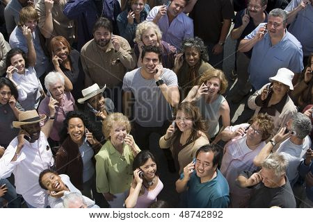 High angle view of multiracial people using cell phones