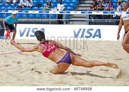 10/08/2011 LONDON, ENGLAND,  Tealle Hunkus (USA) dives for the ball during the FIVB International Beach Volleyball tournament, at Horse Guards Parade, Westminster, London.