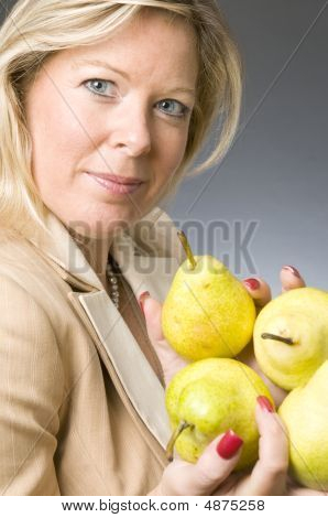 Attractive Blond Woman With Pears Fruit For Healthy Life