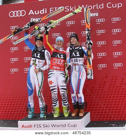 LIENZ, AUSTRIA 28 December 2009. Manuela Moelgg ITA, (L) 2nd Kathrin Hoelzl (GER) (C) winner and Taina Barioz (FRA) (R)  3rd ceremony in the women's Audi FIS Alpine Skiing World Cup giant slalom race.