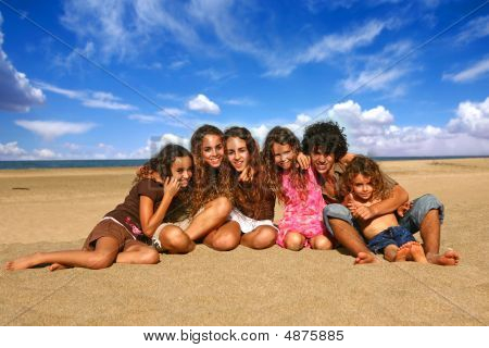 6 Happy Brothers And Sisters Smiling Outdoors At The Beach