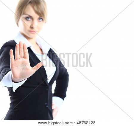 Business woman making stop gesture at white background