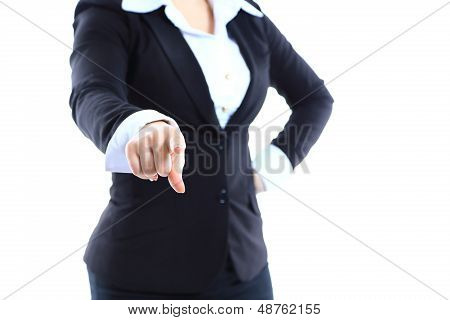 Business woman point finger at you looking at camera.