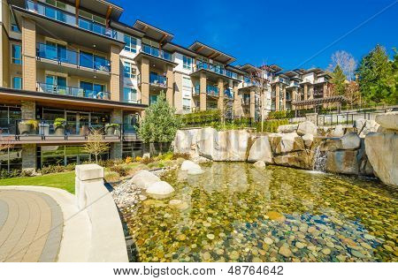 apartment building with outdoor pond in Vancouver, Canada. Residential architecture