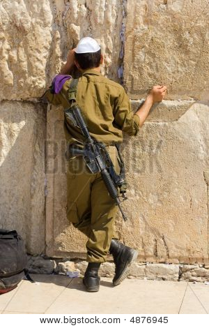 The Israeli Soldier Prays At The Western Wall.