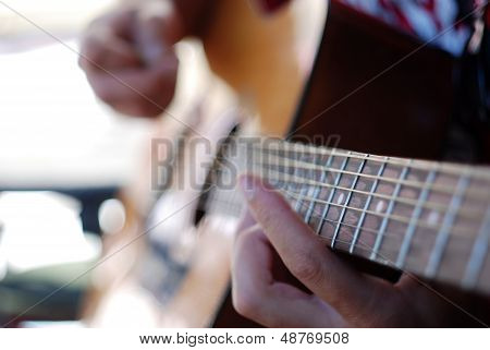 Musician playing old guitar