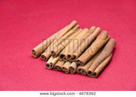 Cinnamon Sticks On Red- Tight Depth Of Field