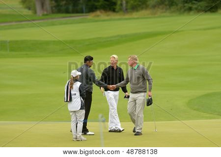 MOSCOW, RUSSIA - JULY 27: P. Hedblom of Sweden (center), R. Finch of England (right), and G. Bhullar of India with his caddie during 3rd round of M2M Russian Open in Moscow, Russia on July 27, 2013