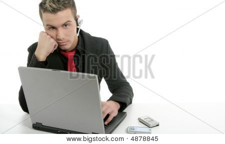 Young Businessman With Laptop And Microphone