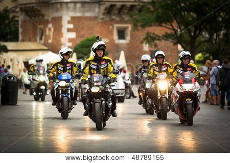 KRAKOW, POLAND - JULY 30: Motorcycle escort for 70th Tour de Pologne cycling 3rd stage race, July 30, 2013 in Krakow, Poland. Tour de Pologne, the biggest cycling event in Eastern Europe.