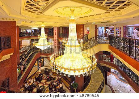 MONTE CARLO, MONACO - JULY 13: Interior view of Metropole Shopping Center with 80 luxury shops and boutiques is one of the popular resorts and places to visit in Monte Carlo, Monaco on July 13, 2013.