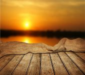 image of wooden table  - Empty wooden table and beautiful summer sunset in background - JPG