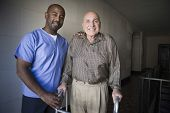 stock photo of handicapped  - Portrait of a male healthcare worker with elderly man - JPG