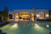 picture of mansion  - Lit swimming pool and building exterior at night - JPG