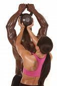 foto of halter-top  - A woman behind a man helping lift a weight - JPG