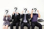 stock photo of interrogation  - Human resource concept Young businessman holding white billboard with a question mark on it and waiting for job interview asian people - JPG