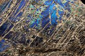 pic of feldspar  - Detail close up of the patterns and colours in the feldspar mineral Labradorite - JPG