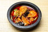Kerala fish curry cooked in a clay pot