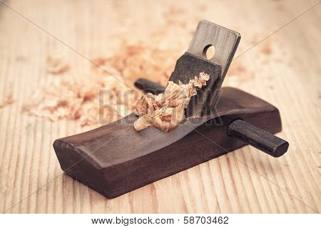 Wood Planer And Shavings Closeup