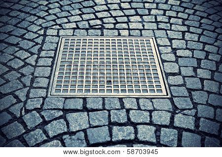Paving Stones With Metal Manhole