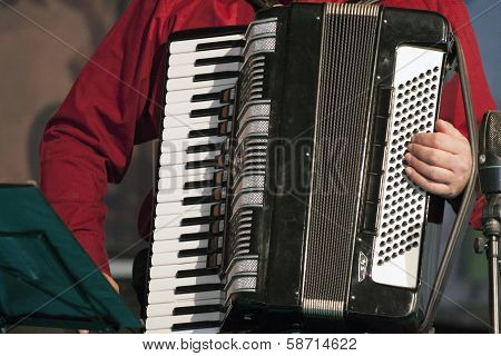 Playing music instrument.