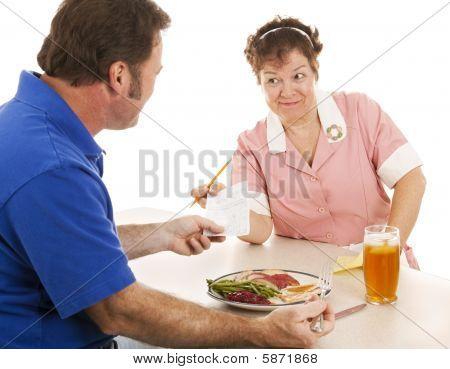 Waitress Hands Customer The Bill
