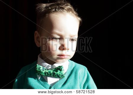 Kid In Green Cardigan And White Shirt