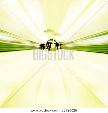 Motion blurred image of subway station with moving trains.
