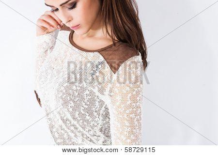 young fashion woman in sheer white sweater studio shot