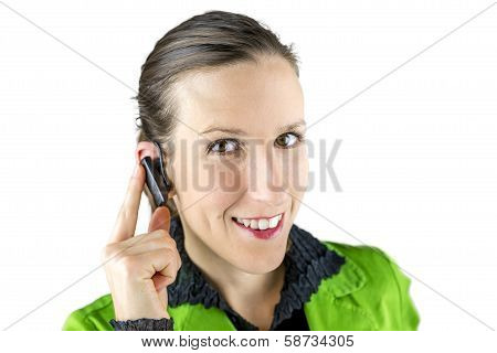 Woman Touching The Hands Free Placed At Her Ear