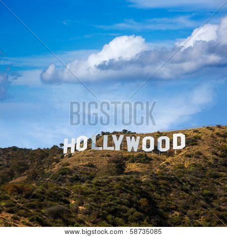 HOLLYWOOD CALIFORNIA - APRIL 12, 2013: Located in Hollywood Hills at Mount Lee the world famous landmark Hollywood Sign in Los Angeles, California on April 12, 2013. Sky clouds are digital improved.