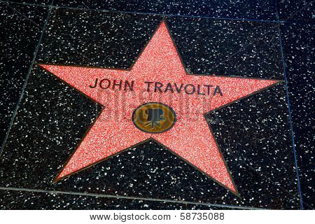 HOLLYWOOD, CALIFORNIA - APRIL 12, 2013: John Travolta Star on Hollywood Walk of Fame in Hollywood California on April 2013. Red star is one of the 2400 celebrity stars located on Hollywood Boulevard.