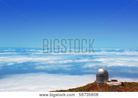 LA PALMA, CANARY ISLANDS, SPAIN - JULY 12, 2012:ORM observatory at Roque de los Muchachos high angle view over a sea of clouds in La Palma, Canary, Spain, July 12, 2012. Controlled by IAC institute.