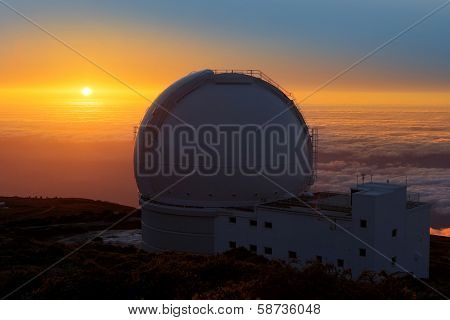 LA PALMA, CANARY ISLANDS, SPAIN - JULY 13, 2012: William Herschel telescope, sea of clouds sunset in ORM observatory by IAC institute at Roque de los Muchachos in La Palma, Canary, Spain, July 2012.