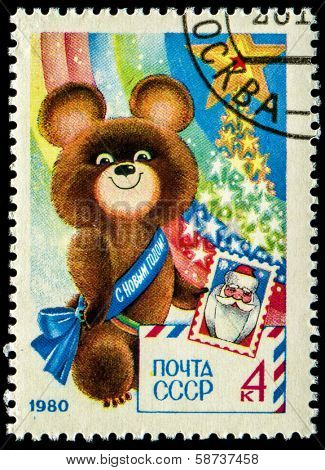 USSR - CIRCA 1980: A stamp printed in USSR shows Olympic Bear Holding Stamp - a symbol of the Moscow Olympics games, New Year 1980, circa 1980