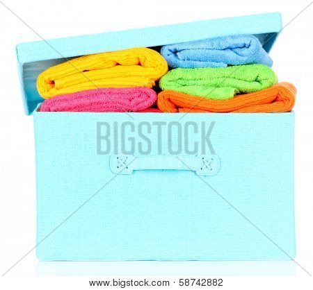 Textile box with bright towels, isolated on white