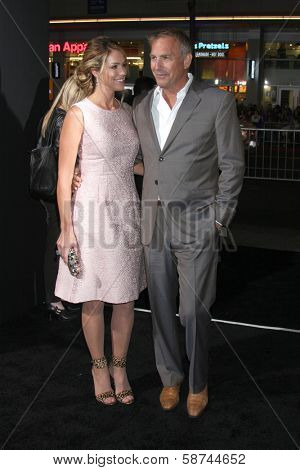 LOS ANGELES - JAN 15:  Christine Baumgartner, Kevin Costner at the