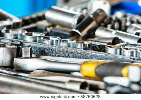 Assortment Kit Of Adjustable Metallic Tools In Mechanic Garage