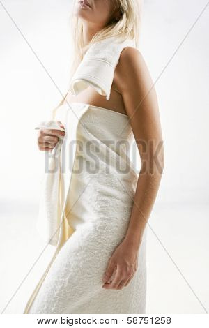 blonde woman in white towel