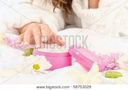 Woman Taking Cream